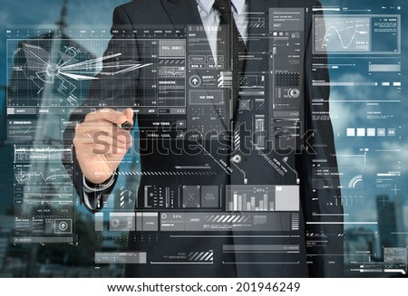 businessman drawing something and sketches in the background is a city landscape - stock photo