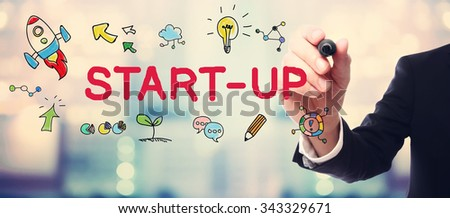 Businessman drawing Start-up concept on blurred abstract background  - stock photo
