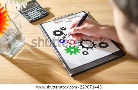 Businessman drawing teamwork concept - stock photo