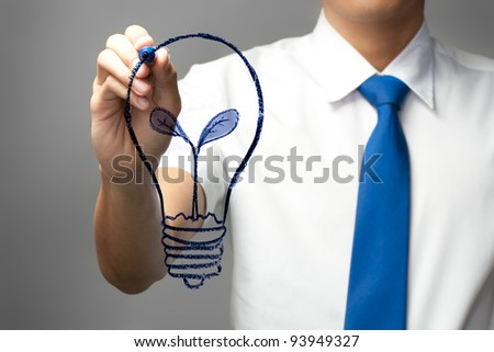 Businessman drawing the bulb on whiteboard - stock photo