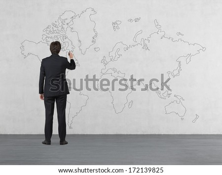 Businessman drawing the map - stock photo
