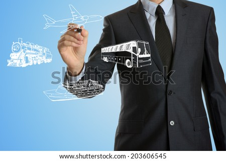 businessman drawing travel means of transport - stock photo
