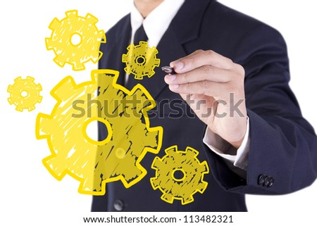 businessman drawing yellow gear on white board