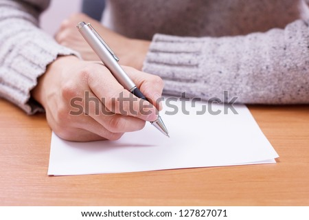Businessman draws a pencil on paper - stock photo