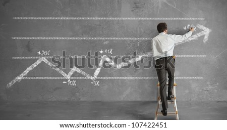 Businessman draws a statistical trend line - stock photo