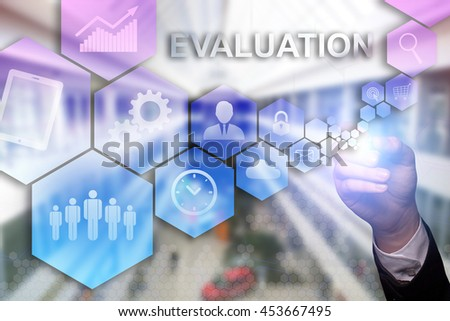 "Businessman draws ""Evaluation"" on the virtual screen. Business concept. Internet concept. - stock photo"