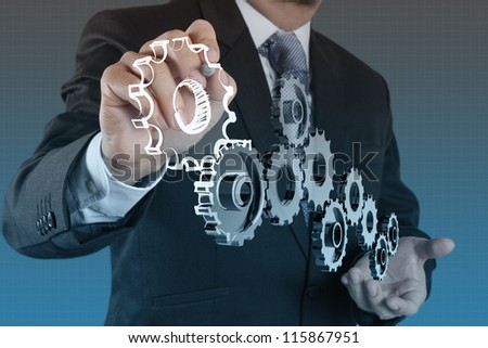 businessman draws gear to success concept - stock photo