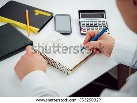 Businessman draws his plan and strategy. Office work