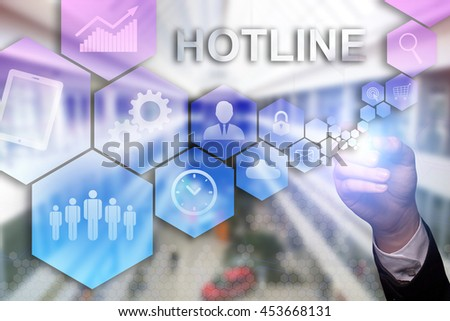 "Businessman draws ""Hotline"" on the virtual screen. Business concept. Internet concept. - stock photo"