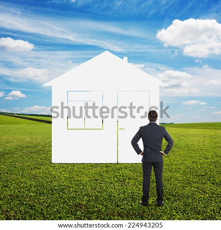businessman dreaming and looking at imaginary house at outdoor - stock photo