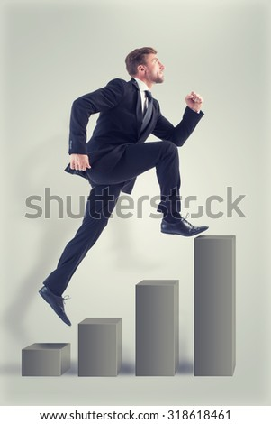 Businessman dreaming of reaching success as soon as possible. Man is running and he does not see any drawbacks on his way. - stock photo