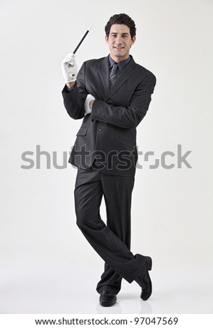 Businessman dressed as magician - stock photo