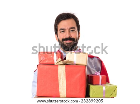 Businessman dressed like superhero holding gifts