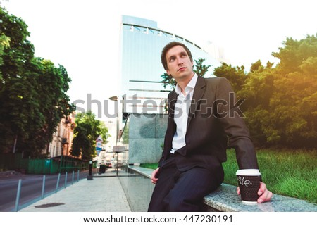 Businessman drink coffee cup. Business male, man. Adult white person. Young people lifestyle. Sitting success serious manager in suit thinking. Coffee brake.  - stock photo