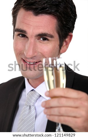 businessman drinking champagne - stock photo