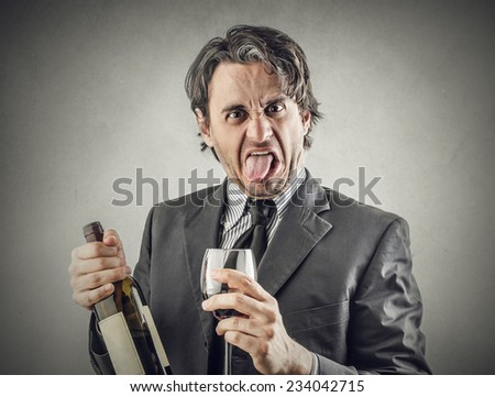 Businessman drinking wine and making jokes - stock photo