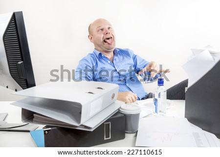 Businessman drinks strong booze at the office