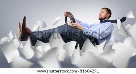 Businessman driver flying through the expanding white paper, concept - stock photo