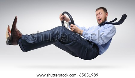 Businessman driver with open mouth in a tie with a wheel concept - stock photo