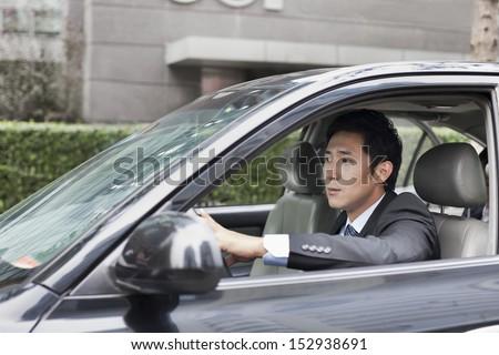Businessman Driving Car - stock photo