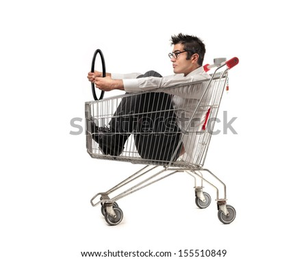 businessman driving in the shopping cart - stock photo