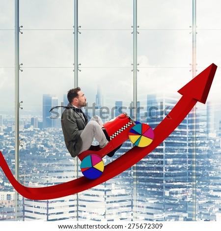 Businessman driving uphill arrow to economic growth - stock photo