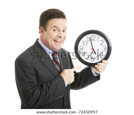 Businessman eagerly pointing to a clock that reads almost 5:00 pm.  He's ready to go home.  Isolated. - stock photo