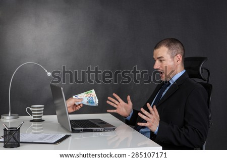 Businessman earning money on network.  He is receiving euro cash over internet. - stock photo