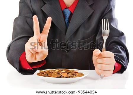 Businessman eating money on a white background - stock photo