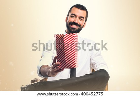 Businessman eating popcorns