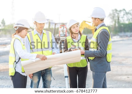 Businessman engineer builder review blueprint during stock photo businessman engineer and builder review blueprint during team meeting at construction site in the morning with malvernweather Gallery