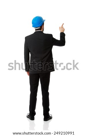 Businessman engineer with hard hat pointing up. - stock photo