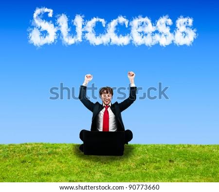 Businessman enjoying a work success - stock photo