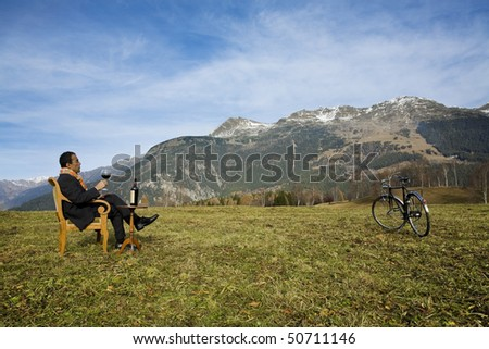 Businessman enjoying nature - stock photo