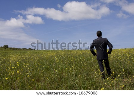 businessman enjoying the nature and planning the future - stock photo