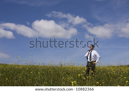 businessman enjoying the nature in a hot summer day - stock photo