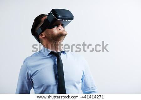 Businessman enjoying virtual reality with simulator - stock photo