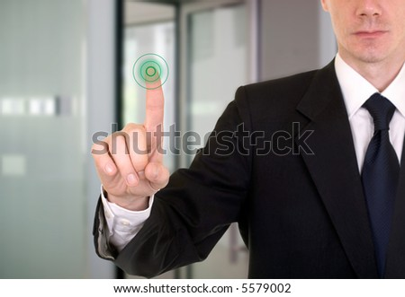businessman entering the bank or secure data by touch screen - stock photo