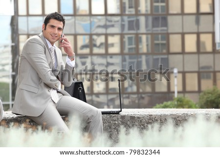 Businessman escaping the office - stock photo