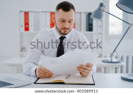 businessman examines documents