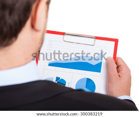 Businessman examining a financial document - stock photo
