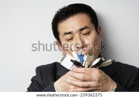 Businessman Examining Data Cable Plugs