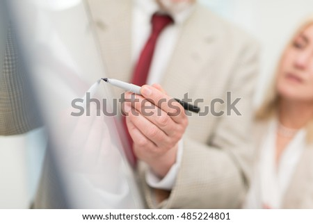 Businessman explaining data on a white board