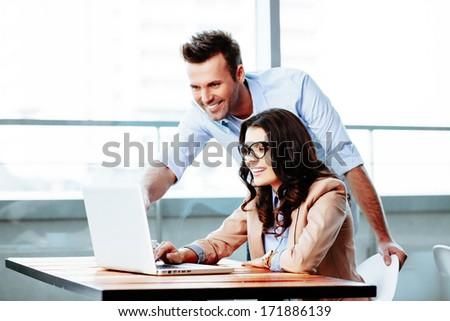 Businessman explains ideas to his female partner - stock photo