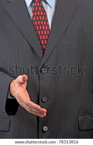 Businessman extending hand for handshake - stock photo