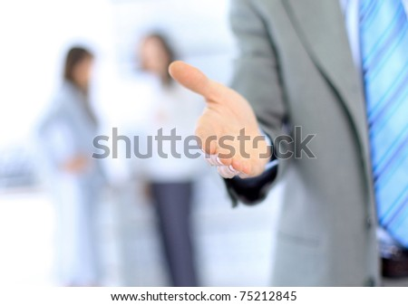 Businessman extending hand to shake - stock photo