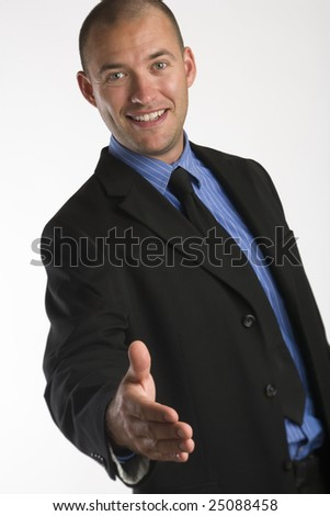 Businessman extending his hand in greeting on white background - stock photo