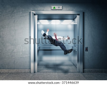 businessman falling in modern elevator