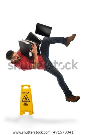 Businessman falling on Wet Floor isolated over white background