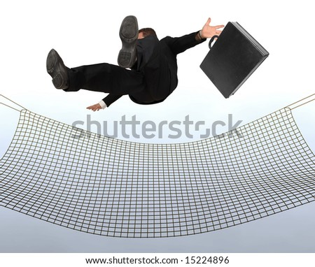 Businessman falling the Sky into a safty net - stock photo